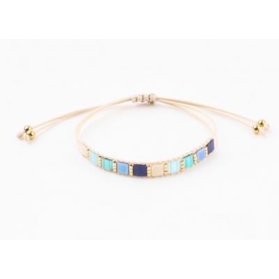 Verstelbaar armbandje blauwtinten.