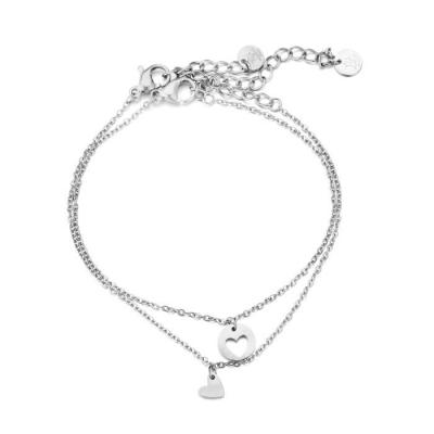 2 losse armbanden: vallend hartje en uitgesneden hartje zilver.