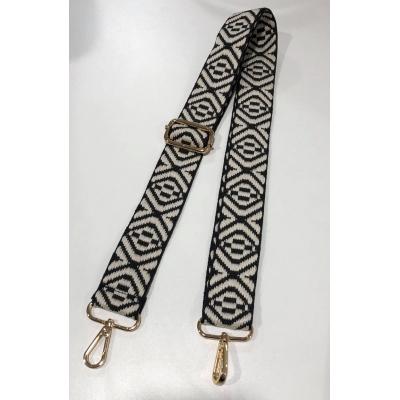 Schouderband zwart/wit met goud.